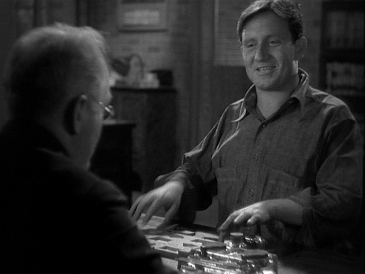 Spencer Tracy is trying to fit round pegs into square holes.